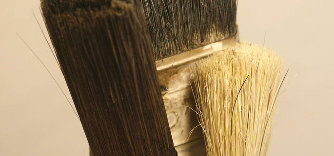 Picture of three paintbrushes in jar