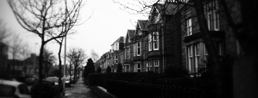 Black and white picture of a street in Aberdeen on a rainy, overcast day