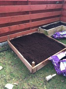 Fully constructed raised bed with fertiliser